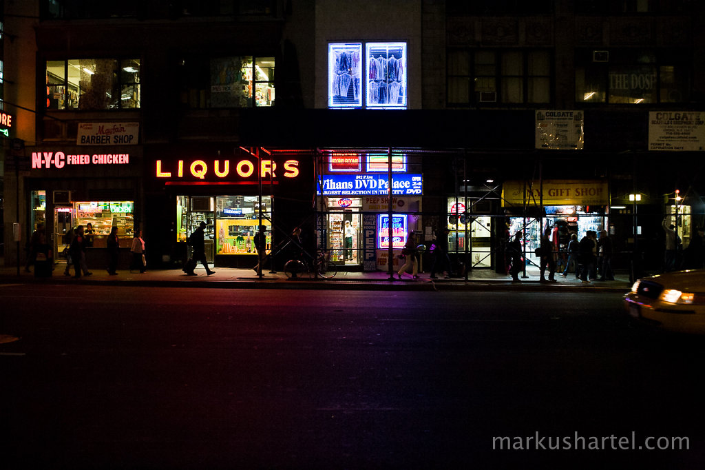 8th Ave store fronts at Night