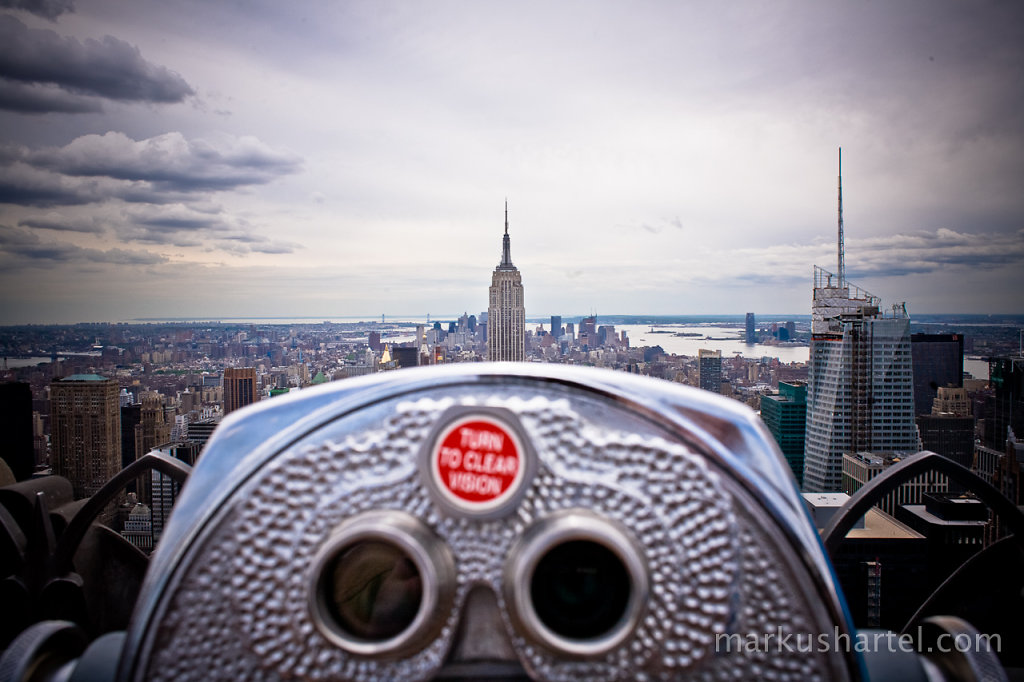 view south over binoculars from Rockefeller Center