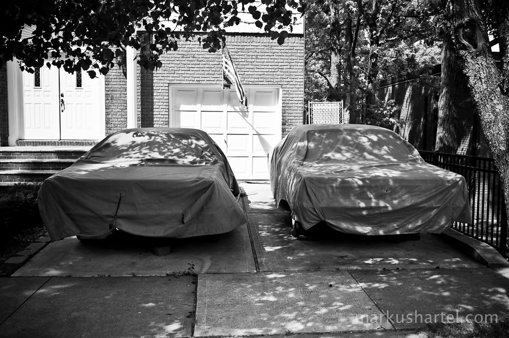 Two Covered Cars