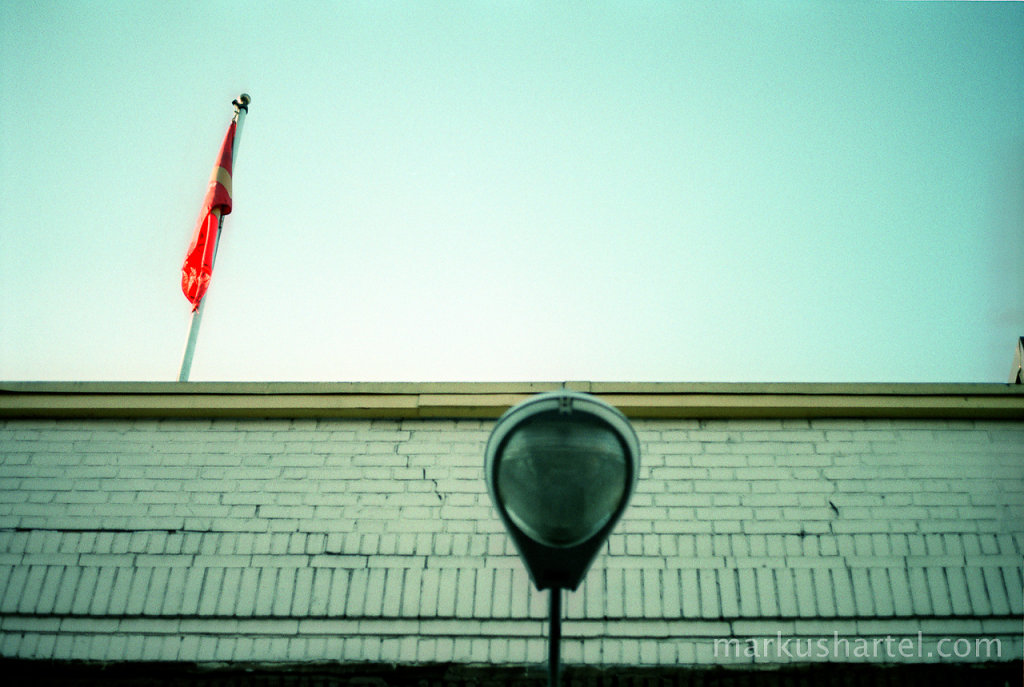 Street lamp and flag